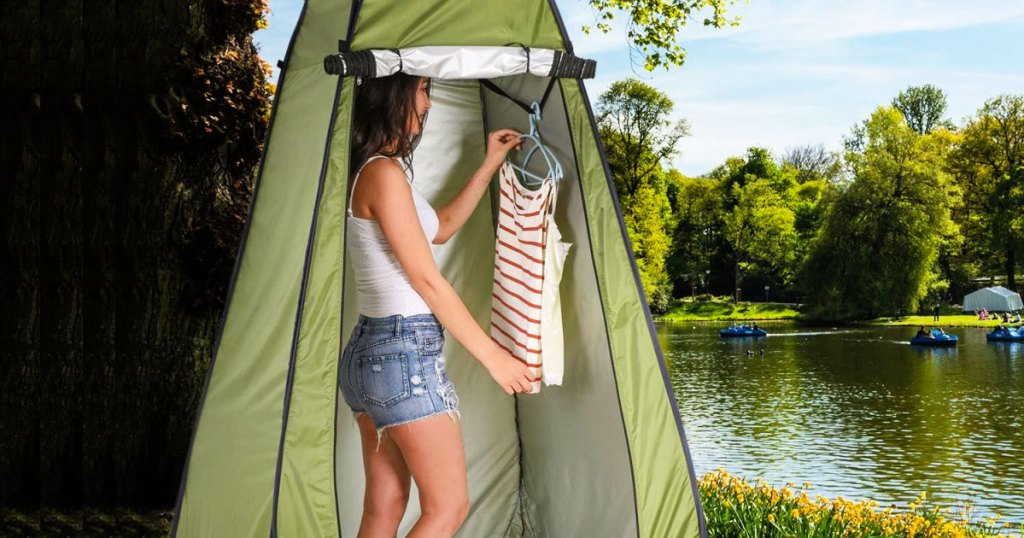 woman changing clothes inside privacy tent