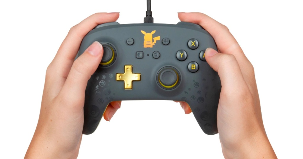 PowerA Pokémon Pikachu Grey Controller in hands
