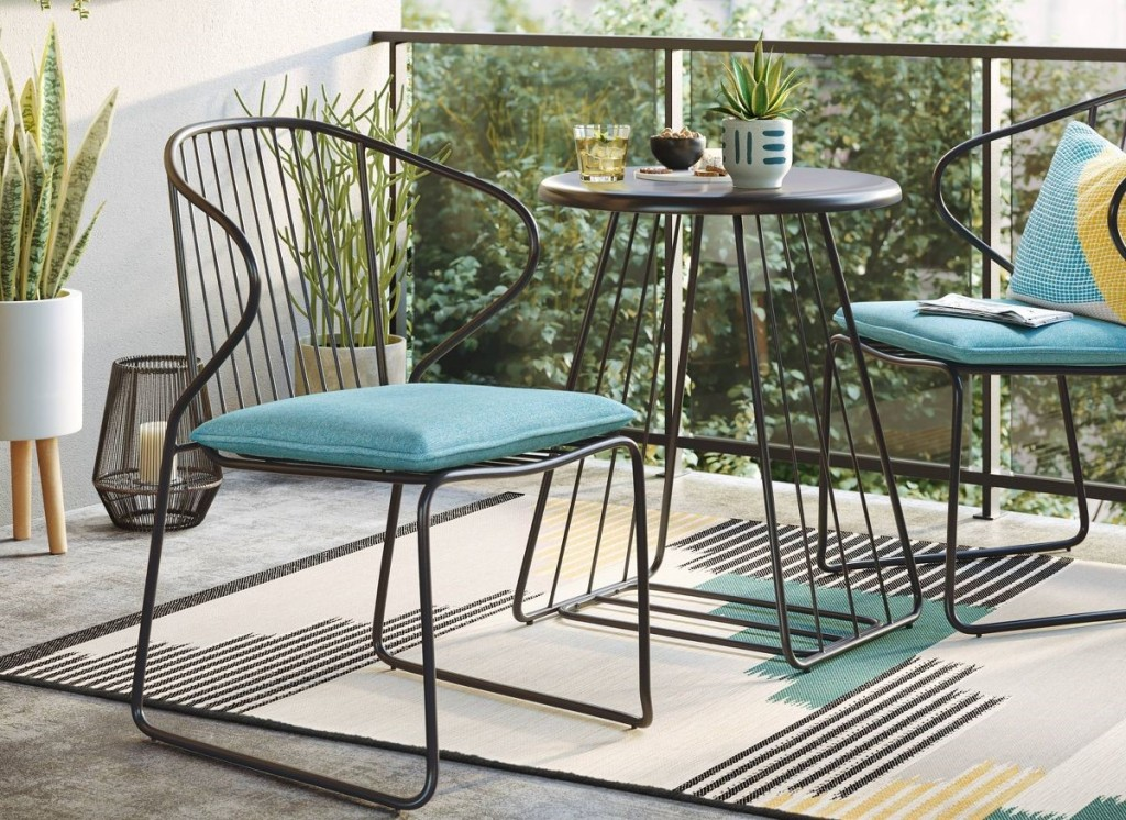 patio set with blue cushions