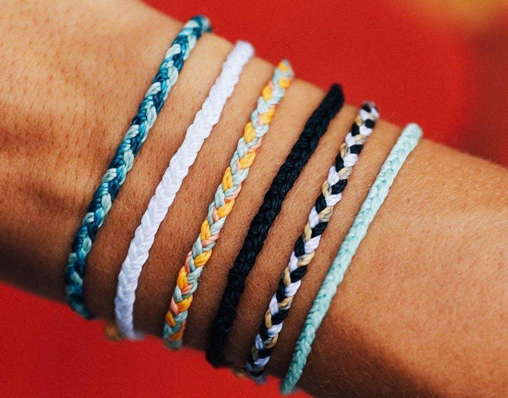 braided bracelets on arm