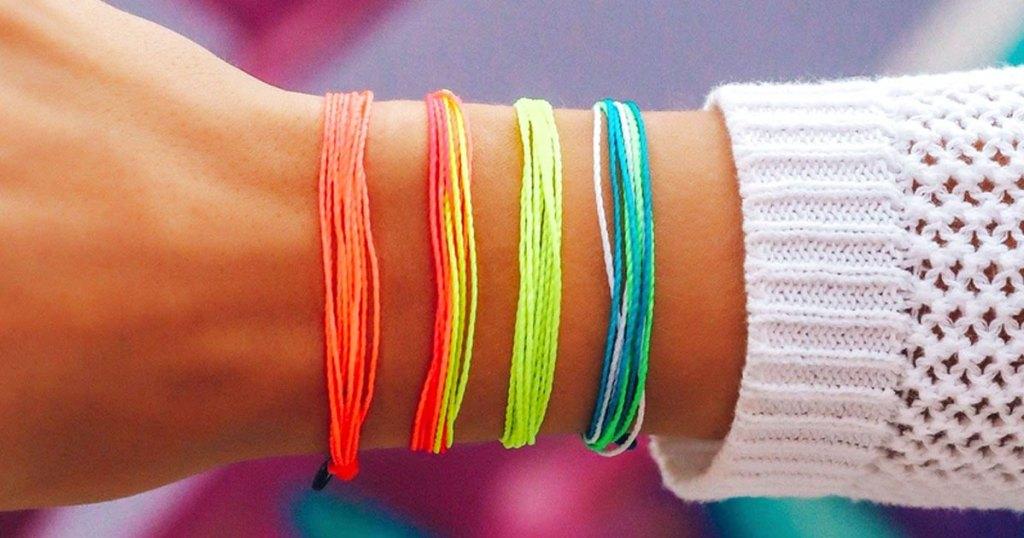 neon bracelets on wrist