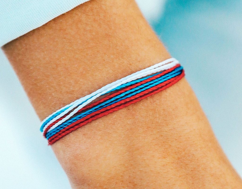 red white and blue bracelet on wrist
