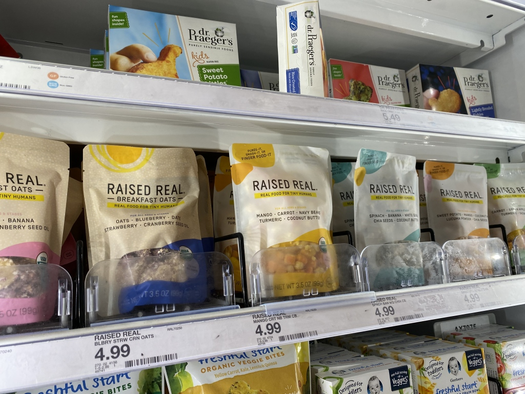 Raised Real Foods in cooler shelves at store