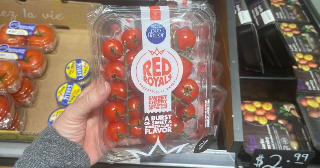 hand holding a package of Red Royals Cherry Tomatoes