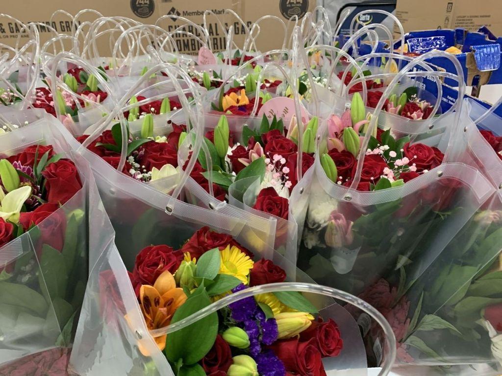 rose vase flower arrangements in clear bag