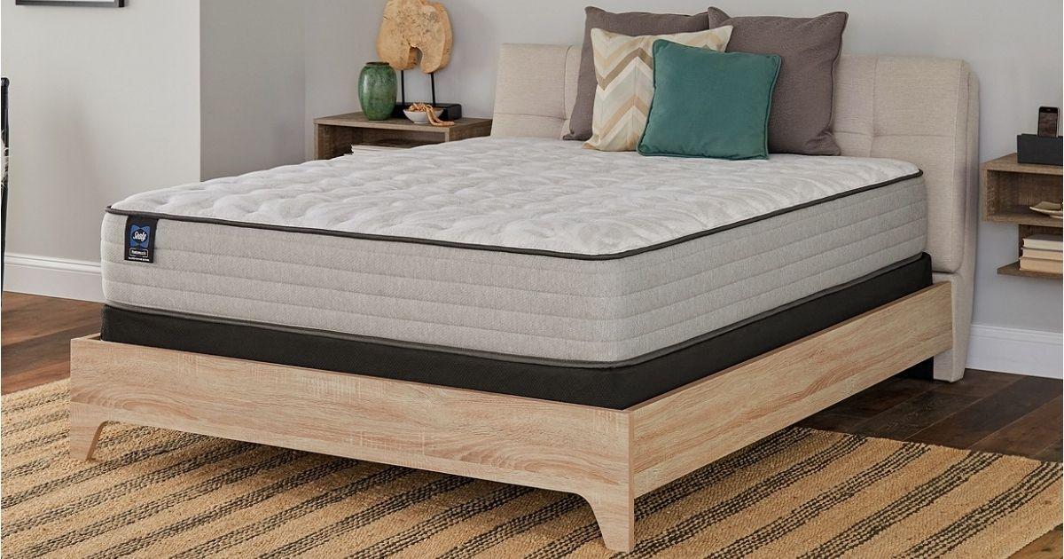 Sealy mattress on wood base