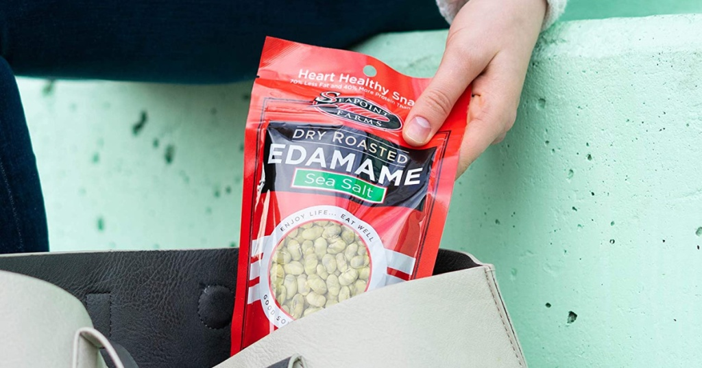 woman dropping Seapoint Edamame in her bag