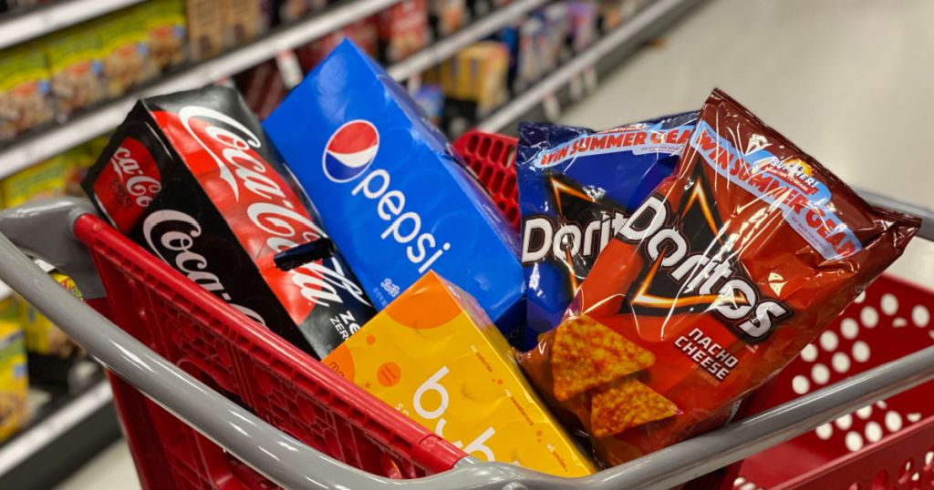 soda, sparkling water and chips in cart
