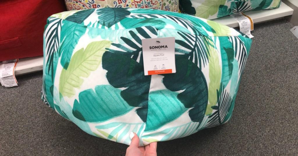 large leaf printed outdoor poof on display in-store