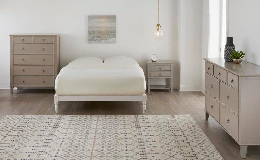 cream platform bed in large bedroom