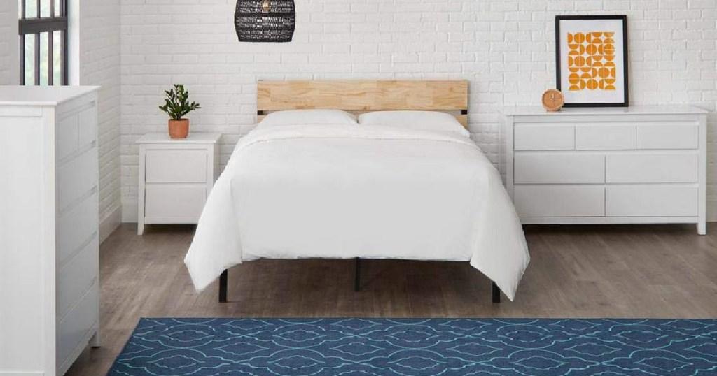 metal and wood platform bed in bedroom