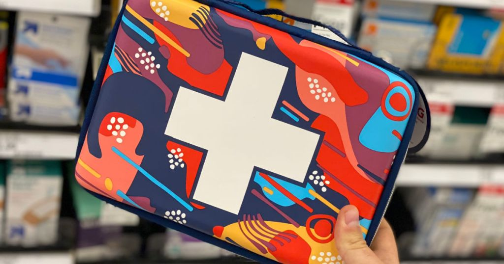 hand holding multi-colored first aid kit