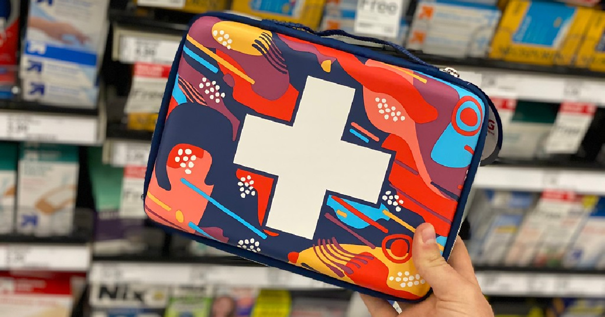 hand holding travel first aid bag in store
