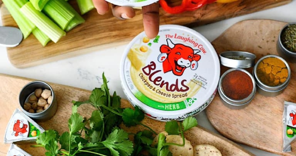 The Laughing Cow Blends Chickpea next to veggies