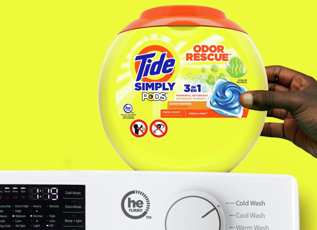 hand holding tide simply pods odor rescue