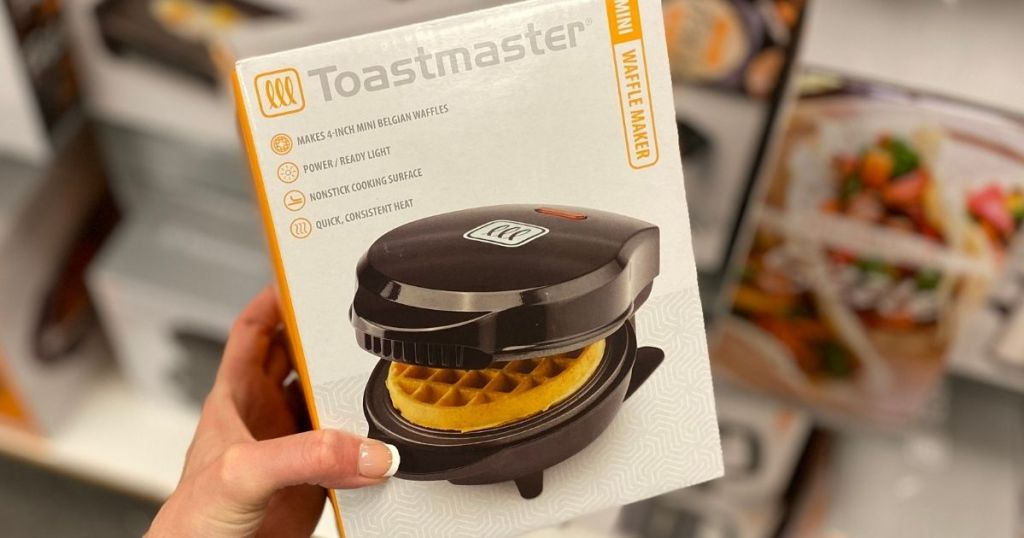hand holding a Toastmaster Waffle Maker