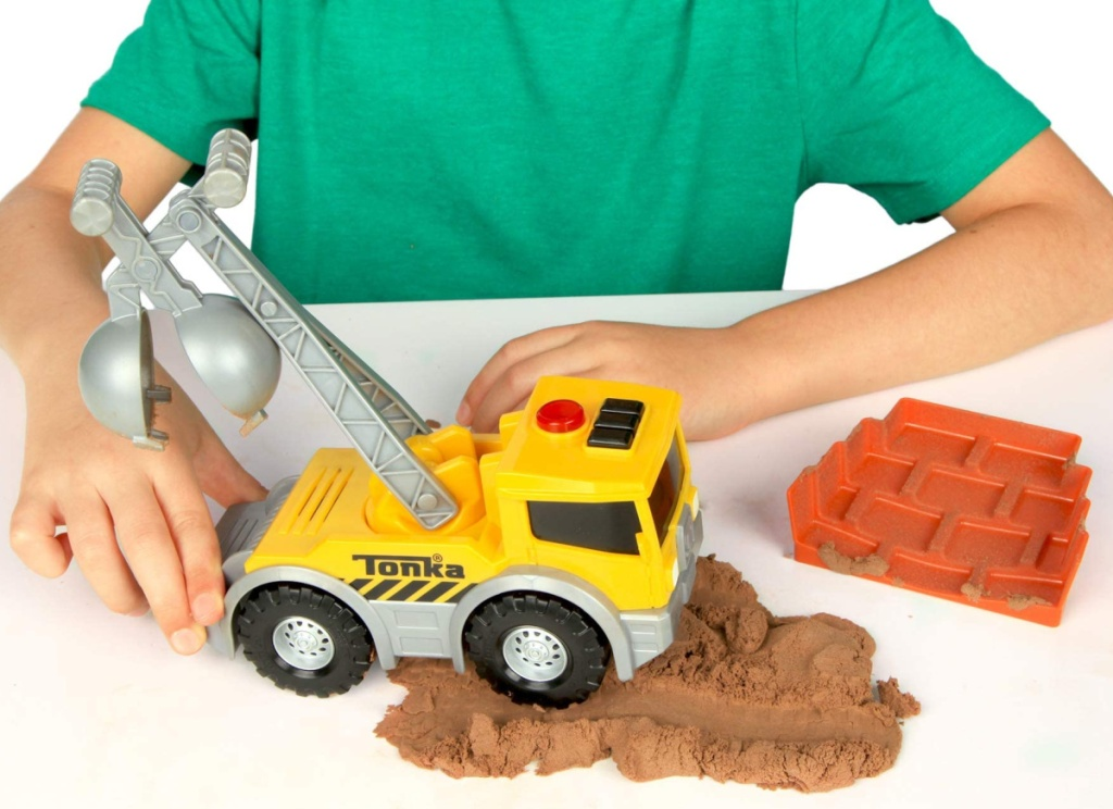 child sitting playing with a tonka truck