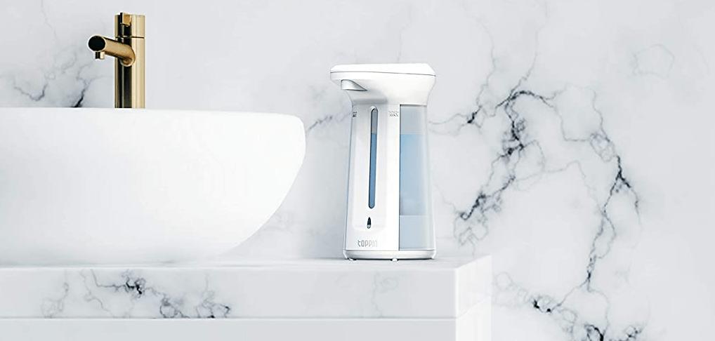 soap dispenser next to a sink