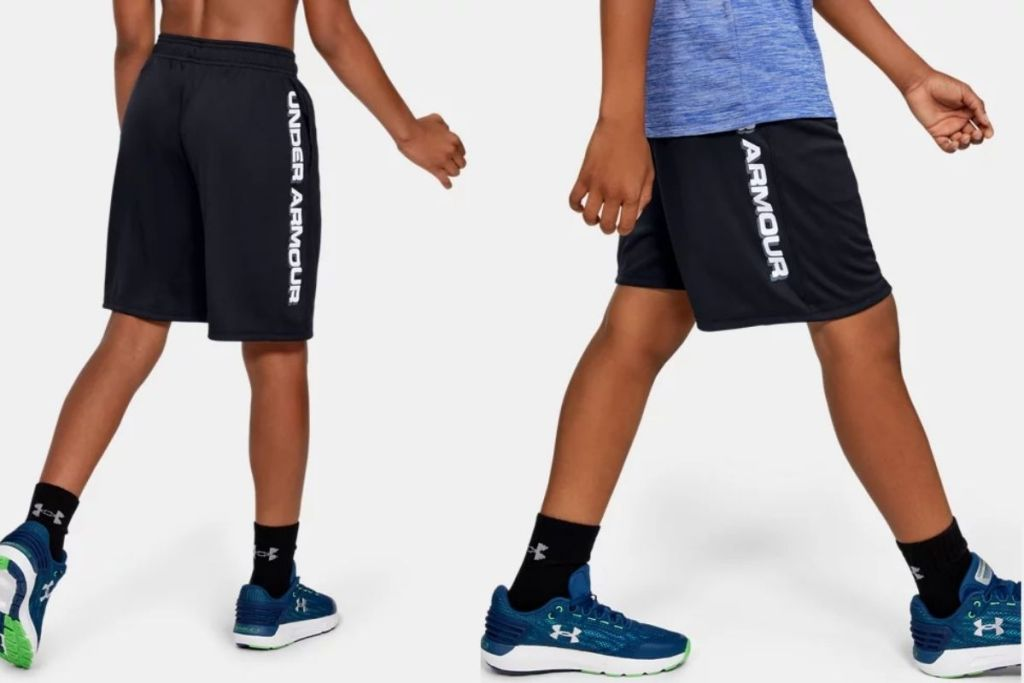 child wearing Under Armour Boys Athletic Shorts