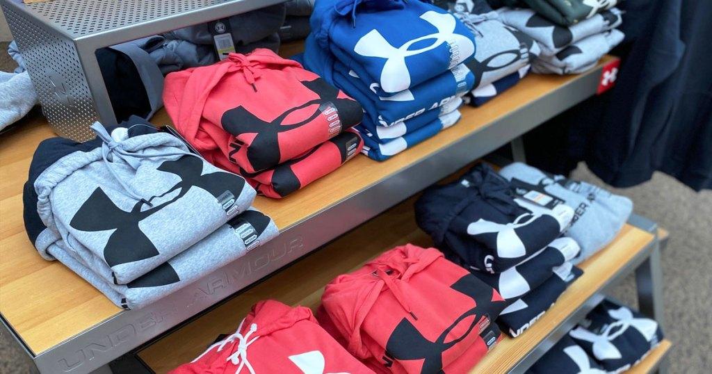 rack of under armour hoodies