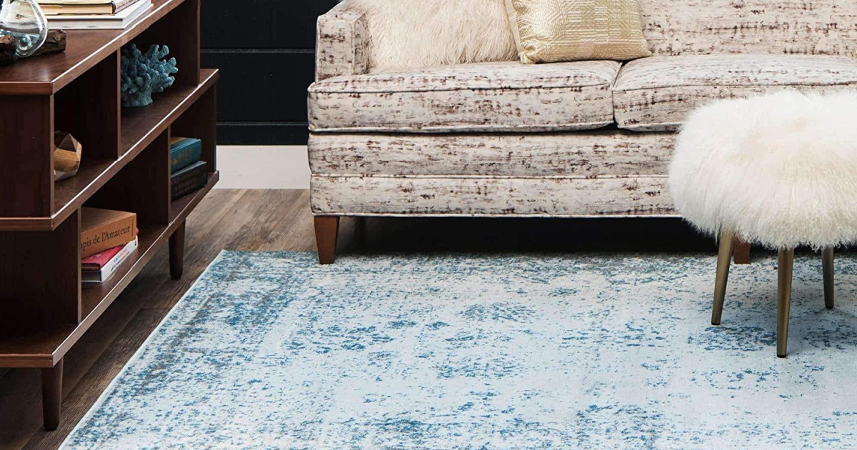 Unique Loom Area Rug in blue under couch