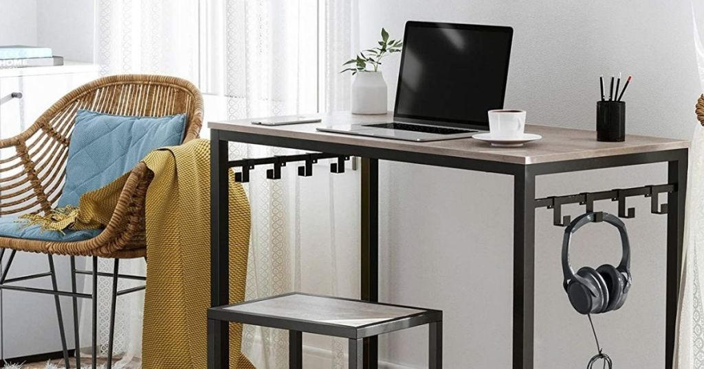computer desk with a stool in front of it