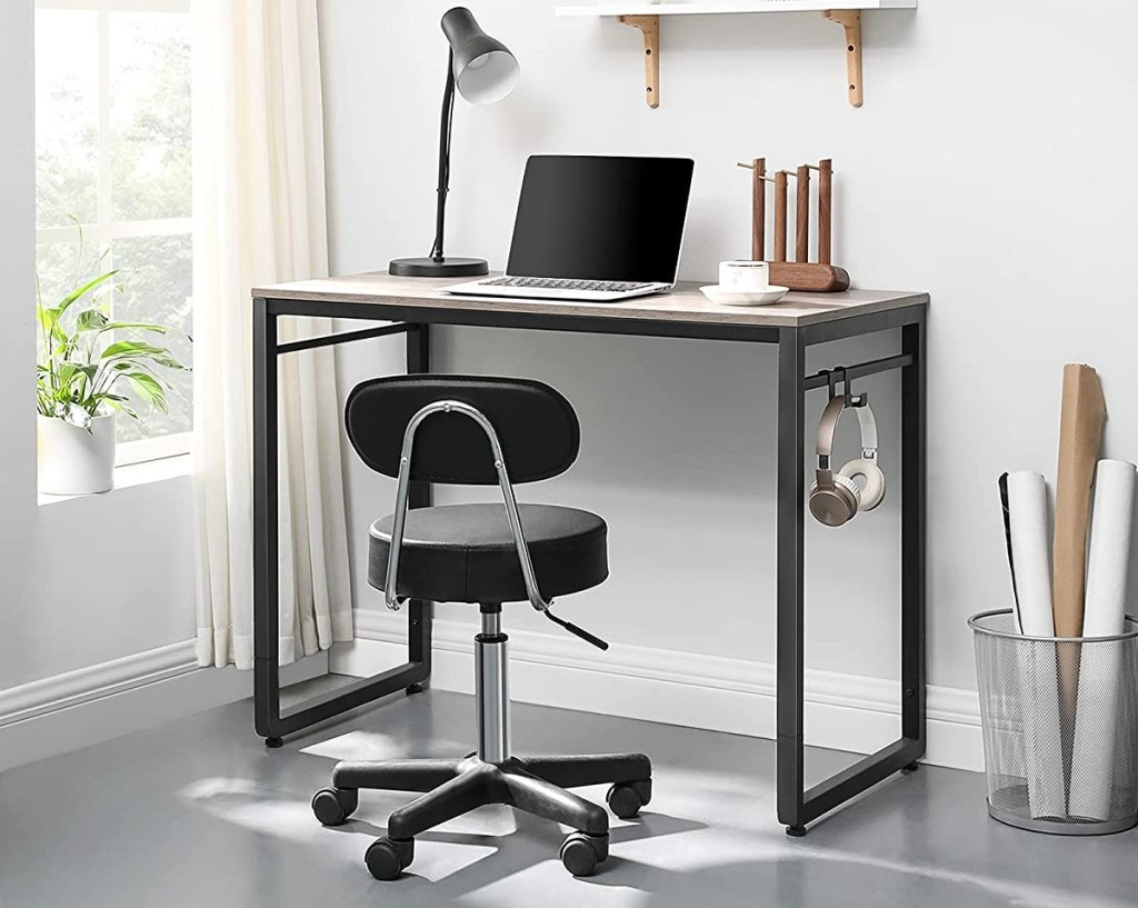 desk with a chair in front of it