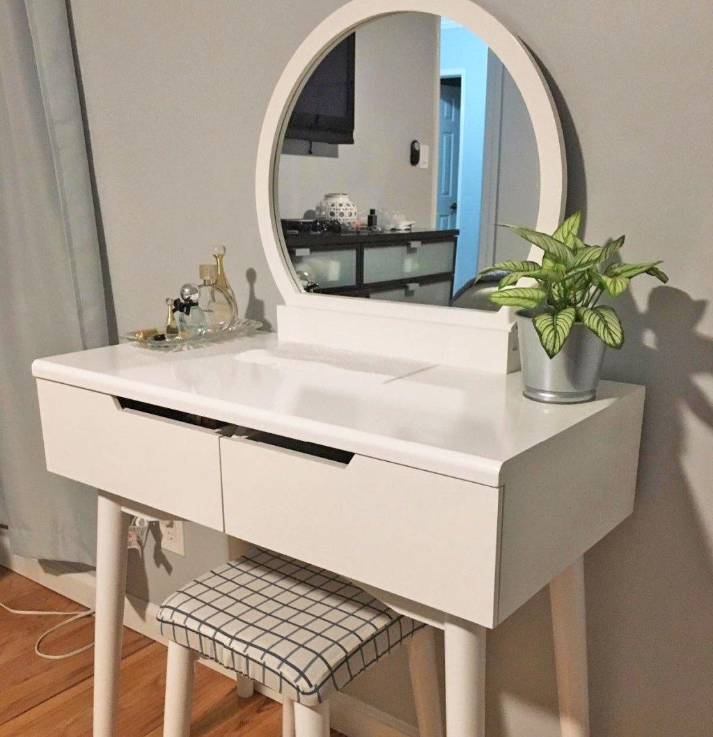 white makeup vanity with round mirror