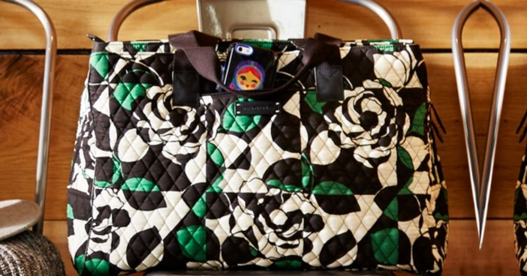 Vera Bradley iphone case in side pouch of bag