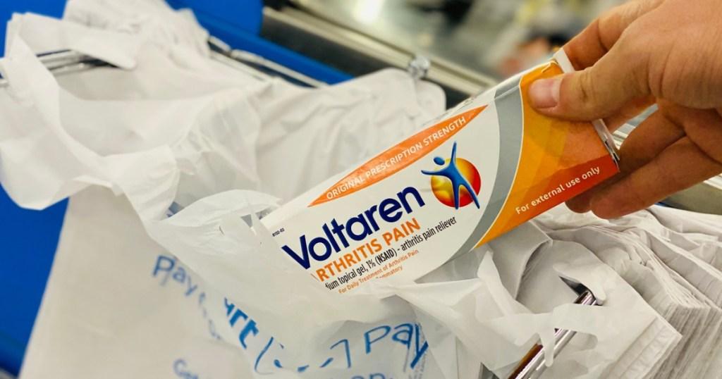 placing voltaren box into walmart shopping bag