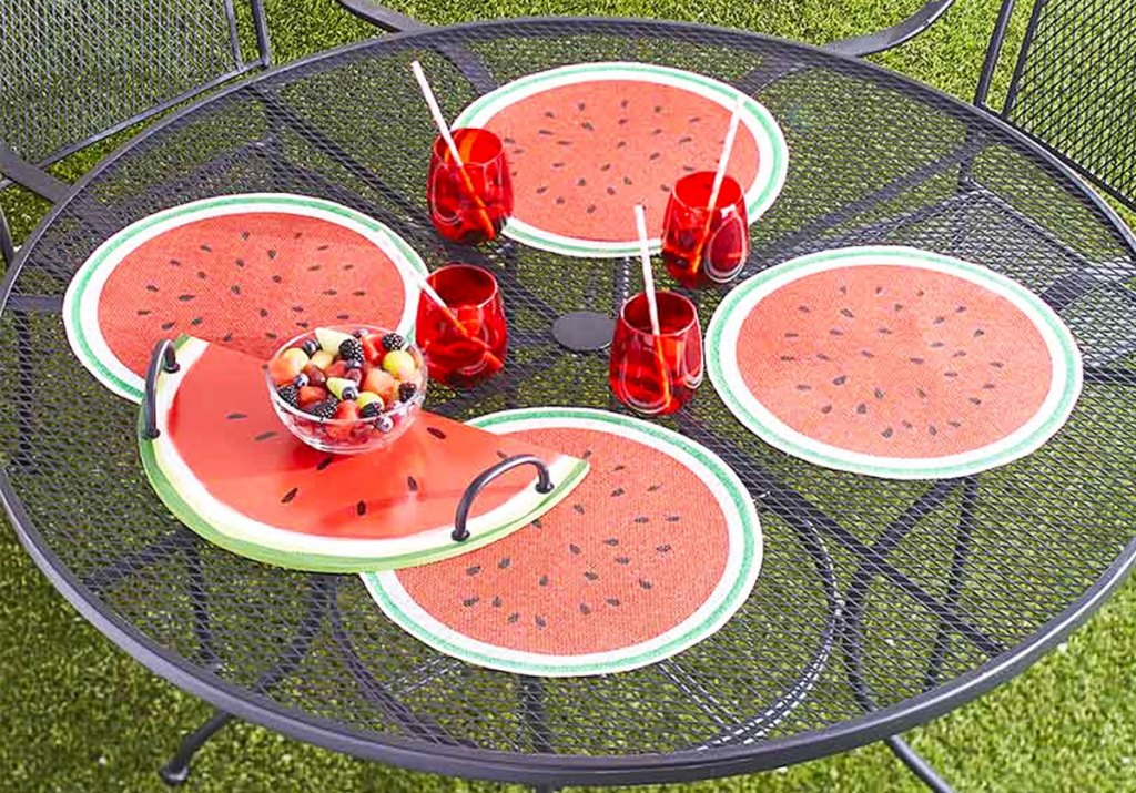 watermelon placemats, serving tray, and red cups on patio table