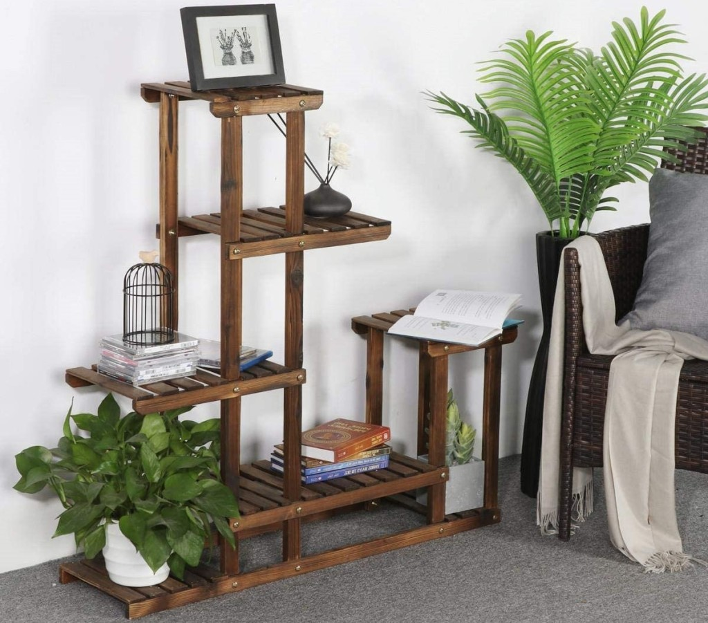 plant stand with plants and pictures on it