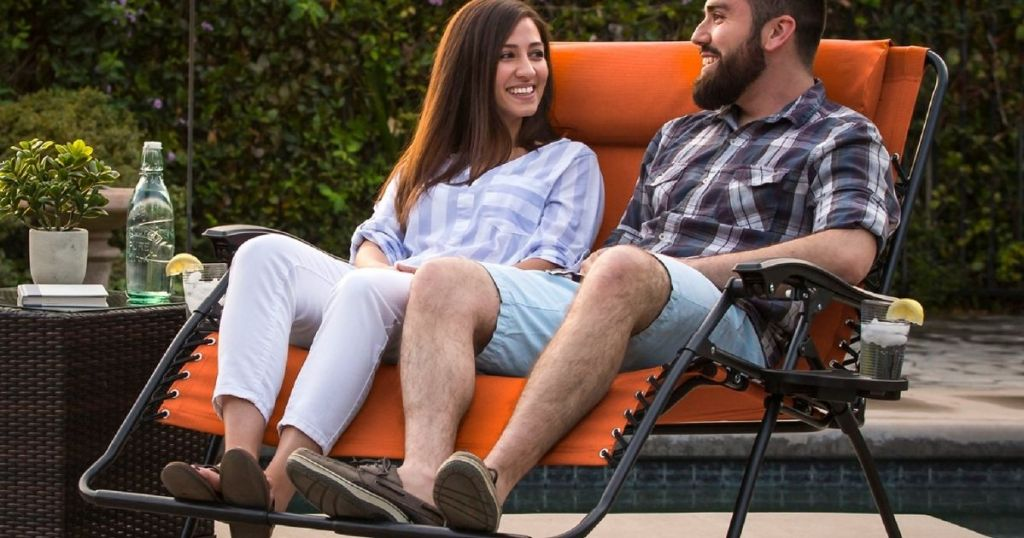 couple sitting on a bench chair