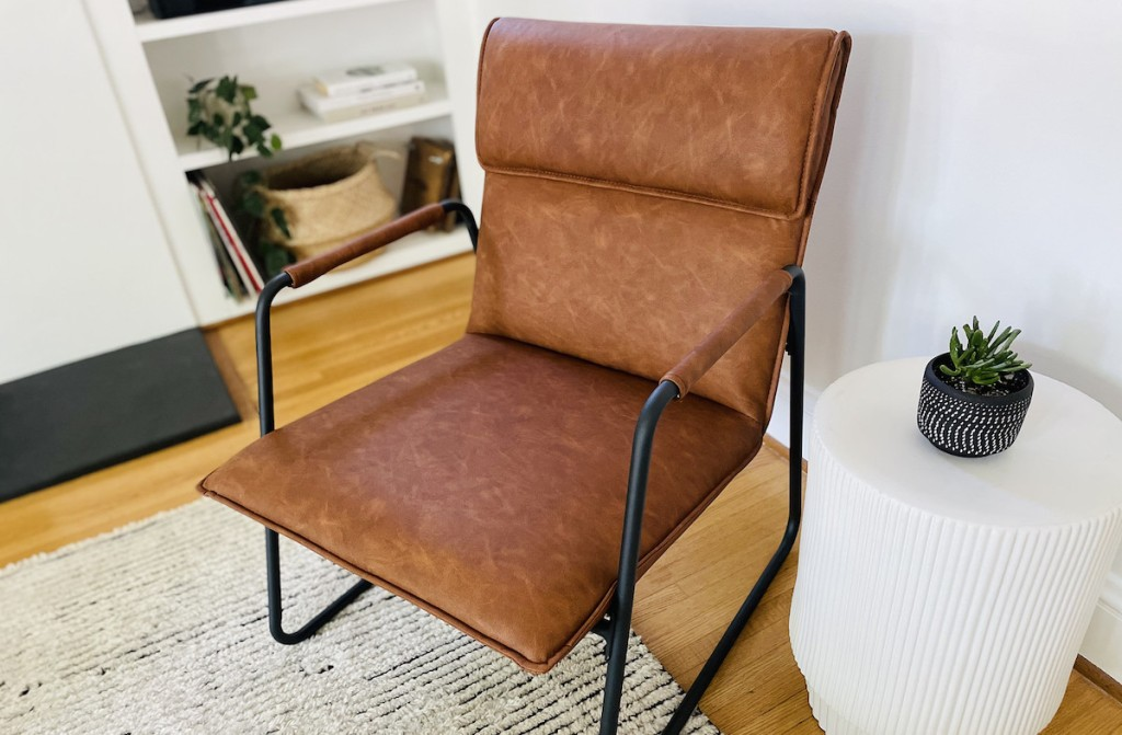 close up of brown leather accent chair in living room