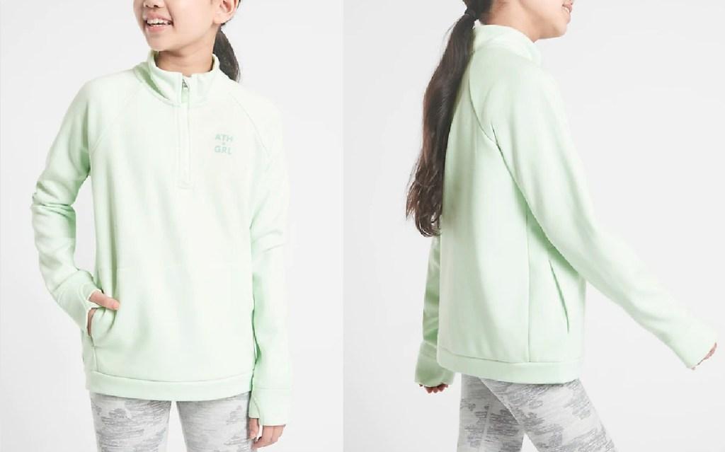 girl wearing mint green sweatshirt