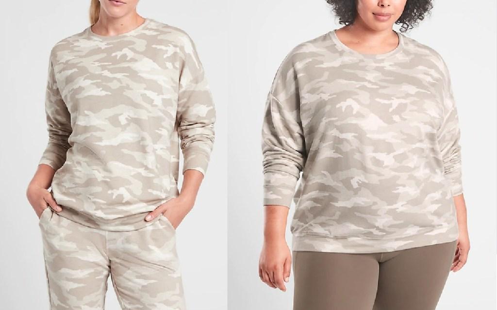 women wearing camo sweatshirts