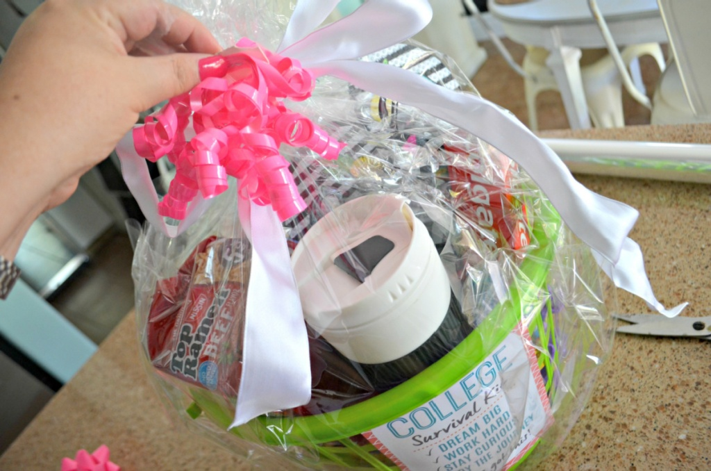 attaching a ribbon to gift basket