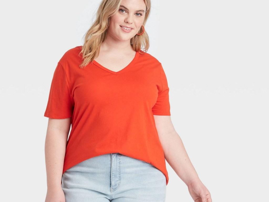 woman wearing bright orange tee
