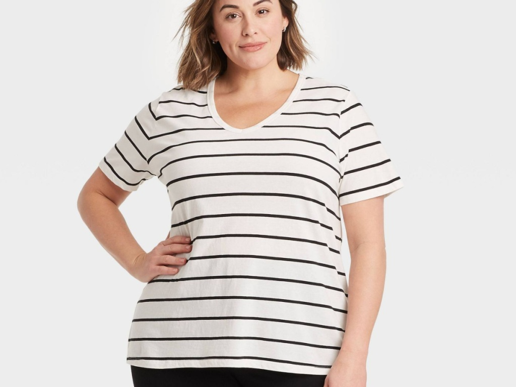 woman wearing white tee with black stripes