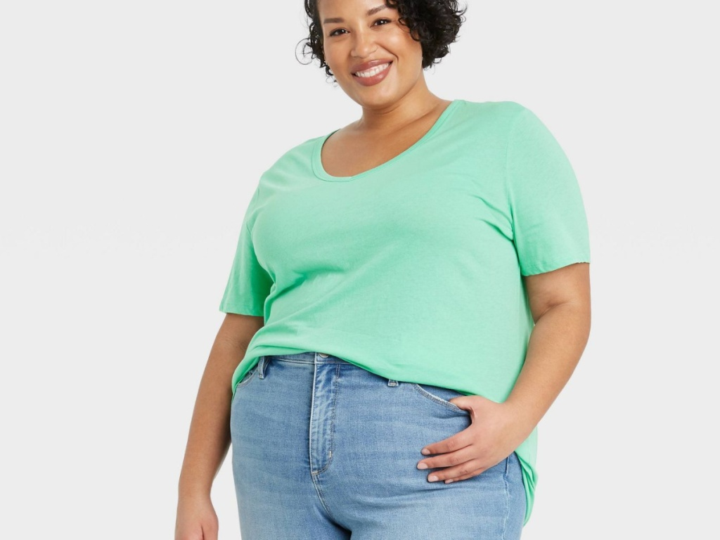 woman wearing mint colored tee
