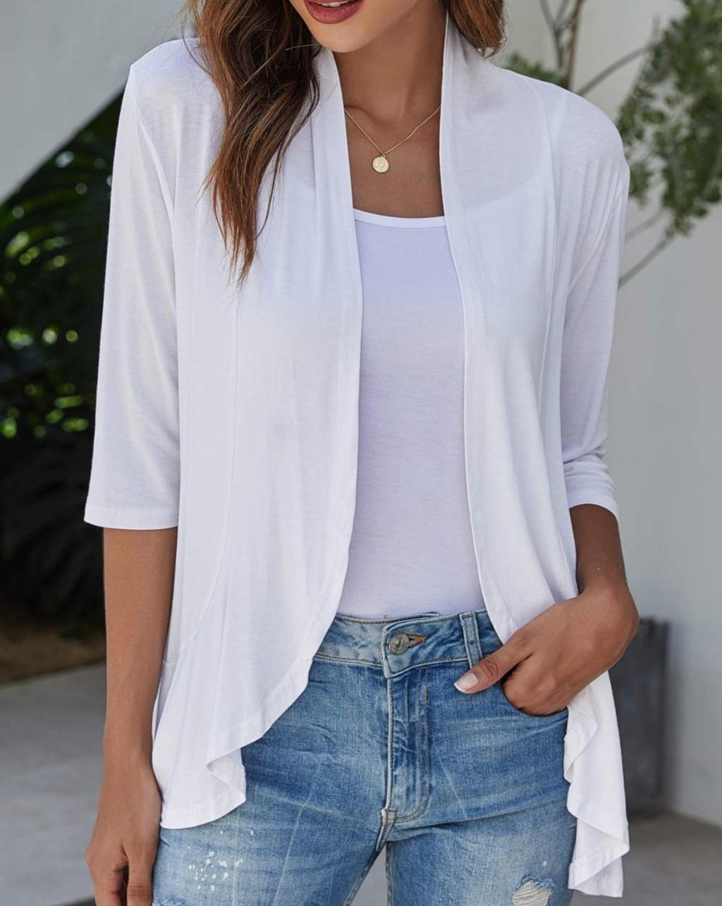 woman wearing white cardigan