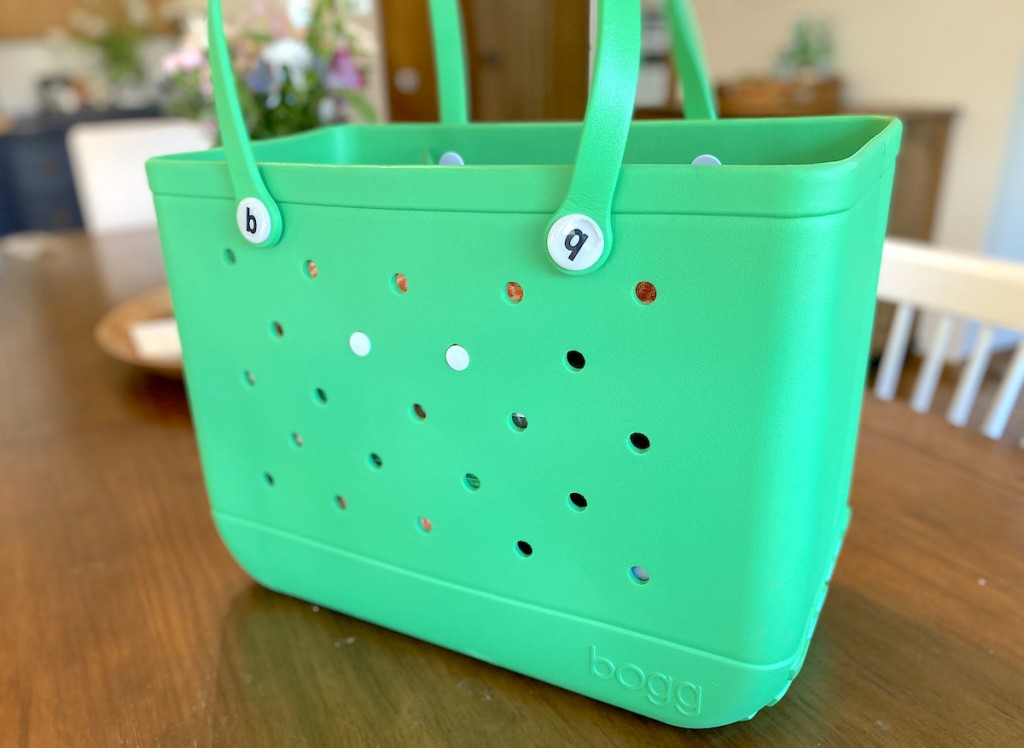 bright green bogg bag on table