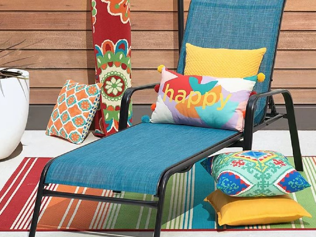 outdoor chair with colorful pillows around it