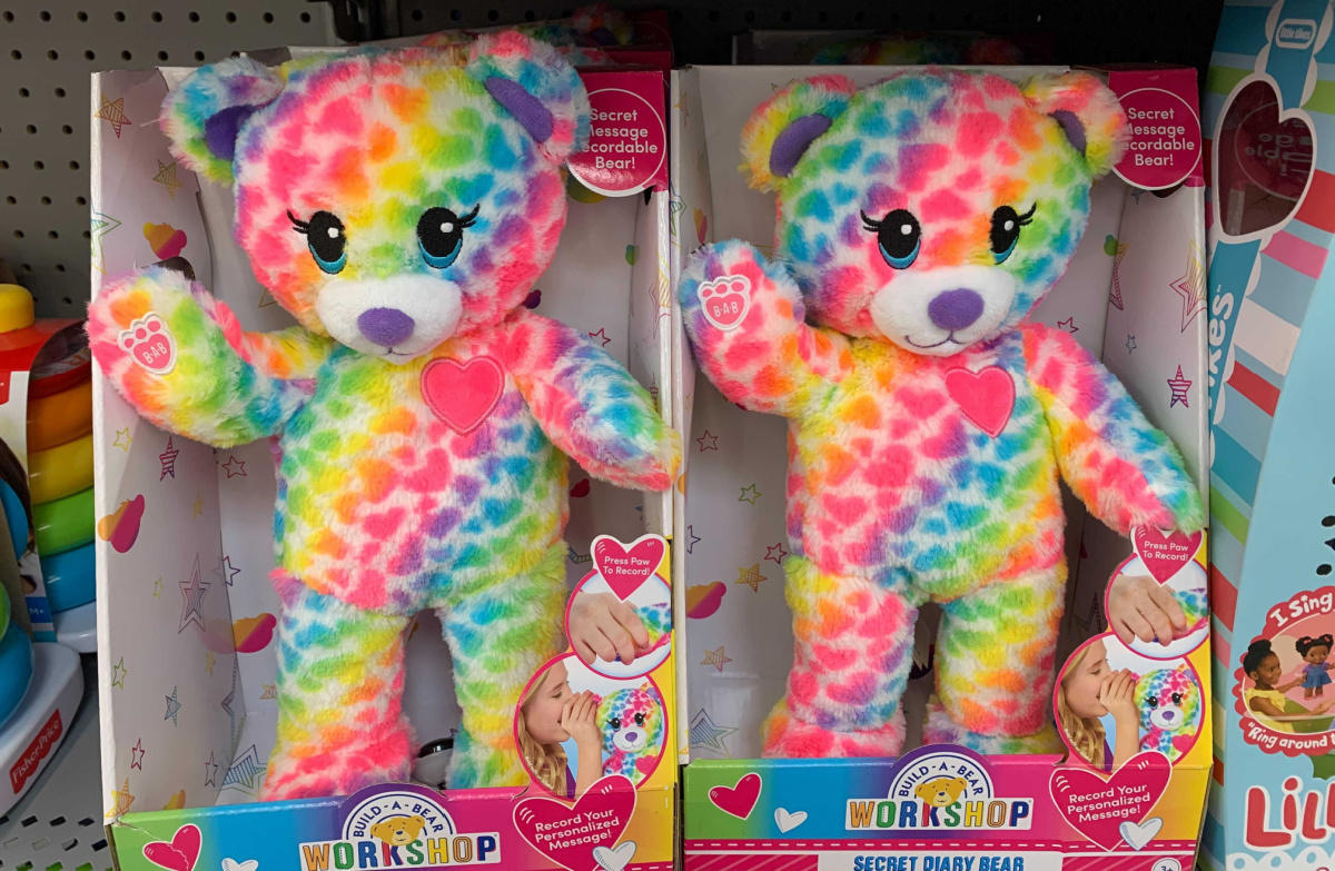 two neon colorful stuffed bears in packaging on a store shelf