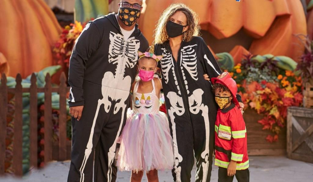 family wearing masks at halloween