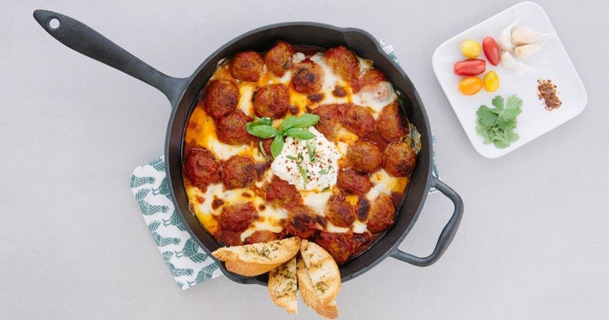cheesy meatballs in cast iron pan