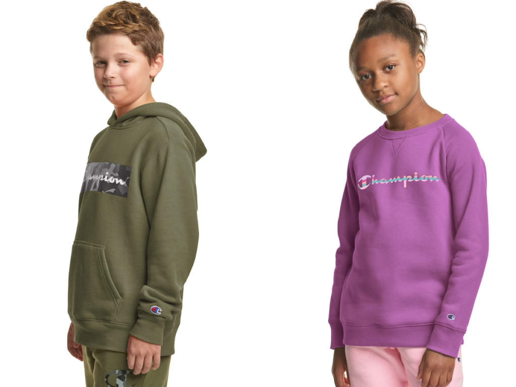 boy and girl wearing sweatshirts staring at camera