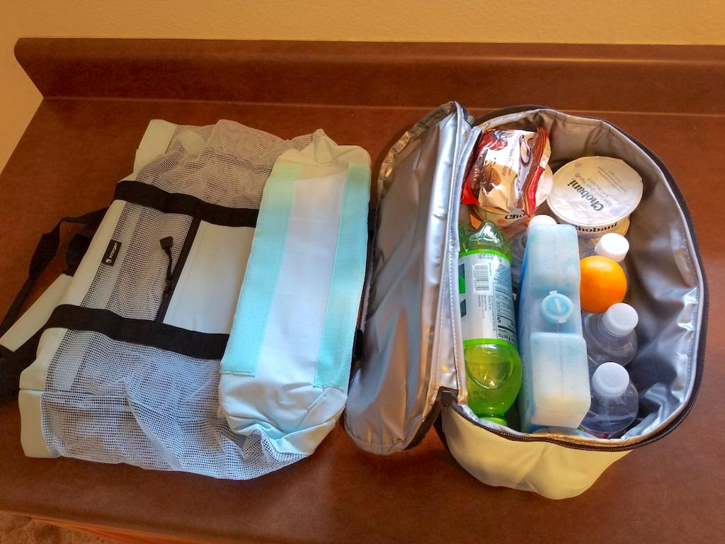 bag with cooler filled with goodies