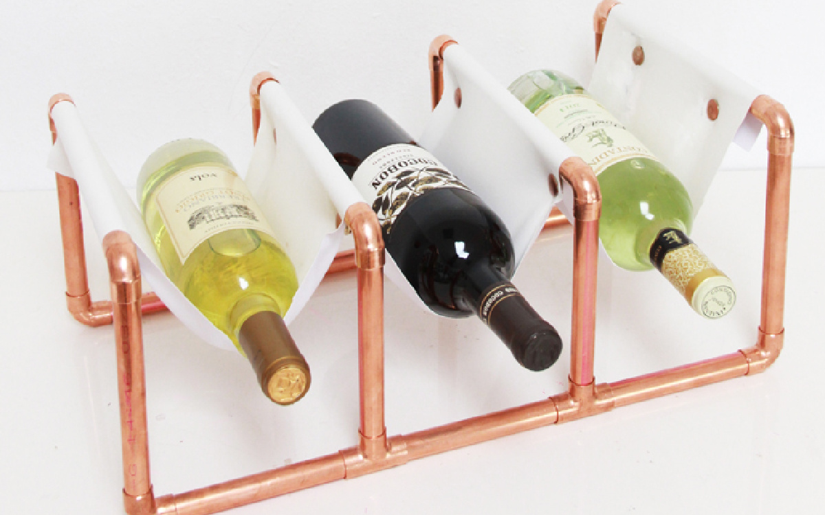 wines on copper wine holder