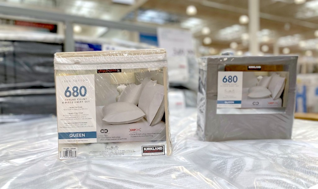 two packages of bed sheets on display in store